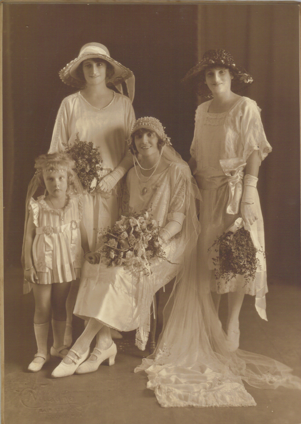 Fig. 6. Left. Studio portrait of the author's grandparents' wedding party 1923, Toowoomba, Queensland. Nellie Stewart bangle is seen on arm of bridesmaid Julie Boyd, far right. Alma Curtis, trainbearer, already wears bangles, possibly given to her upon her christening or birthday.